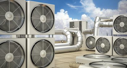 Air conditioning system with air conditioners, ventilators and pipes on top of a building.